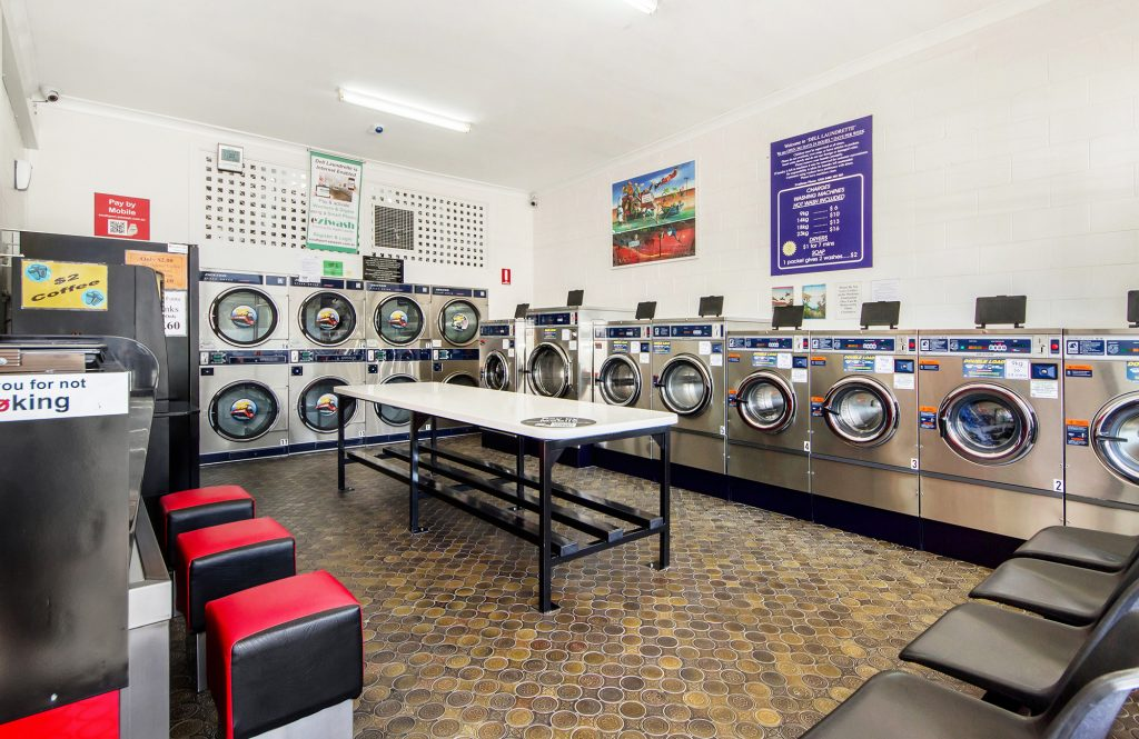 laundromat machine cost